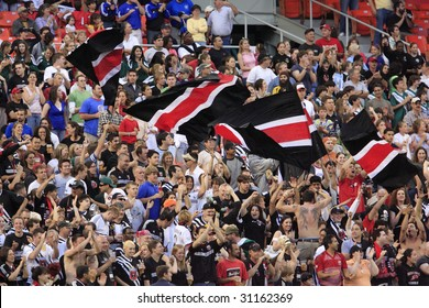 WASHINGTON, DC - MAY 13:  DC United supporters celebrate a goal during a Major League Soccer match against the Kansas City Wizards at RFK Stadium in Washington, DC May 13, 2006.