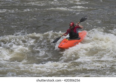 Washington, DC  - May 14, 2016: White water kayakers paddling down Little Falls near lock 5 on the Potomac River