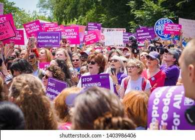 WASHINGTON, DC - MAY 21, 2019: A crowd of women hold signs supporting reproductive justice at the #StopTheBans rally in DC