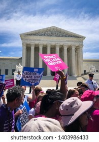 WASHINGTON, DC - MAY 21, 2019: Women hold up signs in front of the Supreme Court to protest abortion bans