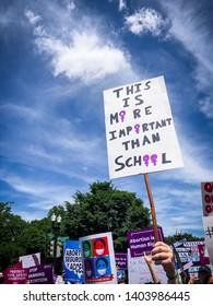 "WASHINGTON, DC - MAY 21, 2019: A woman holds a sign that says ""This is more important than school"" to protest abortion bans"