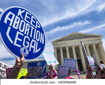 "WASHINGTON, DC - MAY 21, 2019: A woman holds a sign that says ""Keep Abortion Legal"" in front of the Supreme Court"