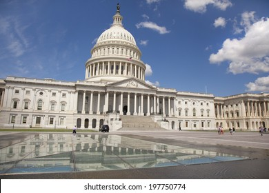 WASHINGTON D.C. - MAY 23 2014: The United States Capitol is the meeting place of the US Congress. Located in Washington, D.C., it sits atop Capitol Hill at the eastern end of the National Mall.
