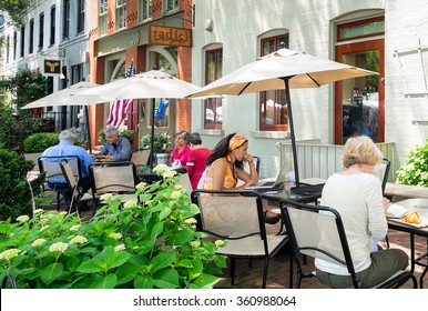 WASHINGTON DC - MAY 24, 2015: People at outdoor sidewalk cafes in the Capitol Hill neighborhood. The area is a popular destination for its shops, restaurants and the historic Eastern Market next door.