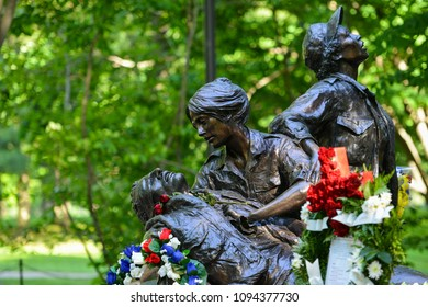 WASHINGTON DC - MAY 26 2014: Vietnam Women's Memorial during Memorial Day in Washington DC, USA. The statue depicts nurses helping soldiers during the war.