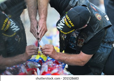 WASHINGTON, D.C. - MAY 26, 2014: A Veteran makes a copy of the name on the name wall  at the Vietnam Veterans Memorial on May 26, 2014, in Washington, D.C.