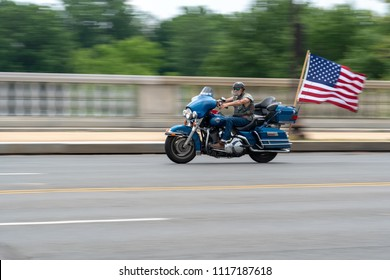 Washington DC May 27, 2018: Rolling Thunder Motorcycle rally crosses Memorial Bridge entering Washington DC from Arlington VA. The rally is to bring attention to POWs and MIAs of US-involved wars.
