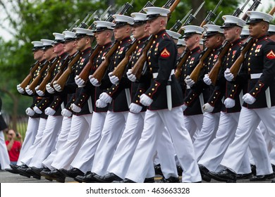 WASHINGTON, D.C. - MAY 30, 2016: Memorial Day Parade. A marching platoon from the United States Marine Corps wearing blue-white dress uniforms.