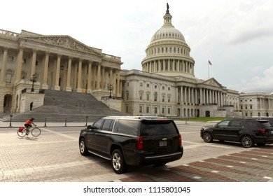 Washington, DC - May 31, 2018: Black cars in front of United States Capitol.