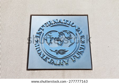 WASHINGTON, DC - MAY 4: Plaque outside the International Monetary Fund (IMF) reflects the blue sky in Washington, DC on May 4, 2015. The IMF, created in 1945, is an organization of 188 countries.