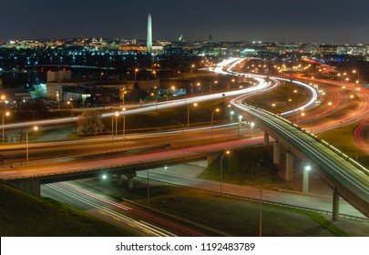 Washington DC at night from above with monuments and traffic