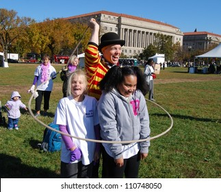 WASHINGTON, DC - NOVEMBER  07: Alzheimer's Walk Event on November 07, 2011 in Washington DC ,USA. Unidentified Children playing with a Circus man during a fund raising event to end Alzheimer's disease.