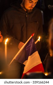 Washington DC- November 15 2015: Crowds gather at Lafayette Square in a candlelight vigil to honor the victims of the attacks in Paris and show solidarity with France
