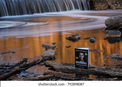 "Washington, DC - November 15, 2016: Tony Robbins' book ""Unshakeable"" is placed in nature."