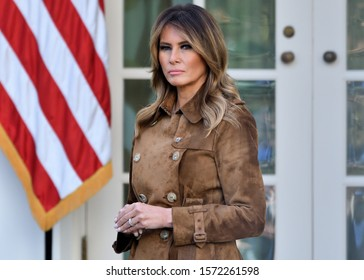 """WASHINGTON, DC - NOVEMBER 26, 2019: First Lady Melania Trump stands with a solemn disposition in the Rose Garden of the White House as the President pardons a Turkey named """"Butter""""."""