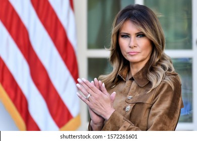 """WASHINGTON, DC - NOVEMBER 26, 2019: First Lady Melania Trump stands with a serious face in the Rose Garden of the White House as the President pardons the Thanksgiving Turkey named """"Butter""""."""