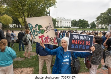WASHINGTON, DC - OCT. 12, 2017: Demonstrators in front of White House protest President Donald Trump's expected decision to unilaterally decertify the 2015 nuclear accord with Iran.