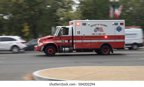 WASHINGTON, DC - OCT. 20, 2016:  EMS Ambulance races by;  EMS is part of the DC Fire Department - DCFEMS.