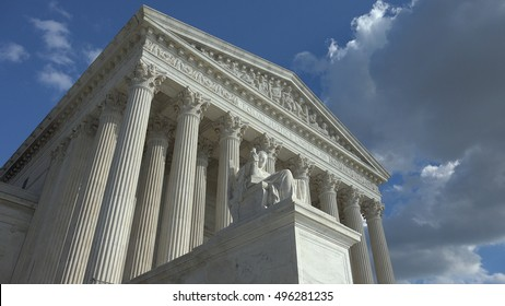 WASHINGTON, DC - OCT 3, 2016:  Equal Justice Under Law engraving above US Supreme Court entrance.  Contemplation of Justice statue in foreground.