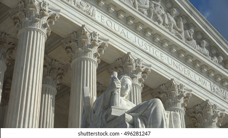 WASHINGTON, DC - OCT 3, 2016:   Equal Justice Under Law engraving above entrance to US Supreme Court Building.  Supreme Court faces the US Capitol Building.