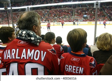WASHINGTON, DC - OCT. 30: Jersey-clad fans watch the Washington Capitals battle the New York Islanders in Washington, DC on Oct. 30, 2009. The Caps lost 4-3 in overtime and star player Ovechkin scored his 14th goal of the season.