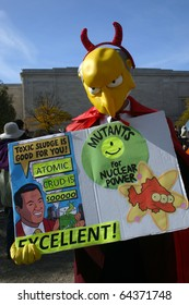 WASHINGTON, DC - OCT 30: A man dressed as the Simpsons' Mr. Burns holds a sign at the Stewart/Colbert Rally to Restore Sanity and/or Fear, Oct. 30, 2010 on the National Mall in Washington, DC.
