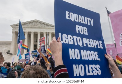 WASHINGTON, DC - OCT. 8, 2019: Rally for LGBTQ rights outside Supreme Court as Justices hear oral arguments in three cases dealing with discrimination in the workplace because of sexual orientation.