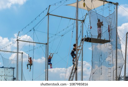 Washington, D.C. October 10, 2017: First time flyers seek aerial adventure on the high flying trapeze at The Trapeze School of New York in the Capitol Riverfront neighborhood of Washington, D.C.