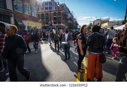 WASHINGTON, DC - OCTOBER 13, 2018: People walk in the closed off street during the H Street Festival in Washington DC