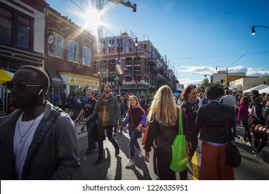 WASHINGTON, DC - OCTOBER 13, 2018: The sun shines down on the crowd during the H Street Festival in Washington DC