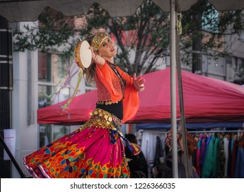 WASHINGTON, DC - OCTOBER 13, 2018: A woman dances with a tambourine at the H Street Festival in Washington DC