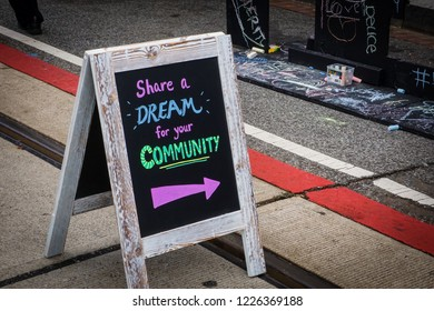 WASHINGTON, DC - OCTOBER 13, 2018: A sign invites people to share a dream for their community during the H Street Festival in Washington DC