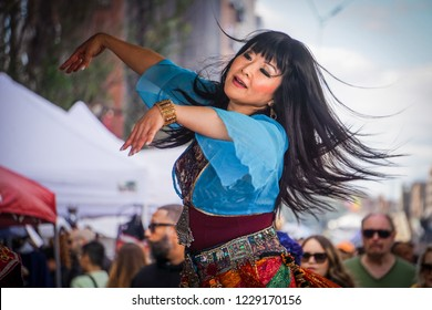 WASHINGTON, DC - OCTOBER 13, 2018: A woman belly dances at the H Street Festival in Washington DC