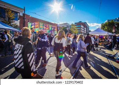 WASHINGTON, DC - OCTOBER 13, 2018: The sun is shining on people attending the H Street Festival in DC