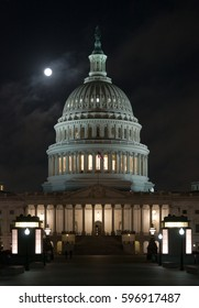 Washington, D.C - October 16, 2016: A supermoon sets over the Capitol in the early morning hours..