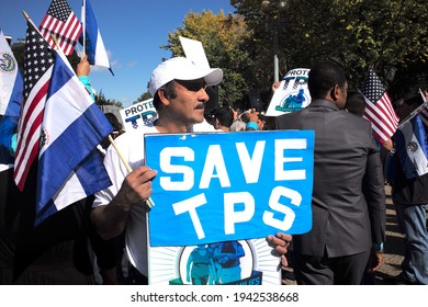Washington, DC – October 23, 2017: Immigration reform protesters demonstrate outside the White House calling for no further deportations and a means to gain legal residency and a path to citizenship.
