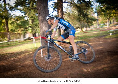 WASHINGTON, DC - OCTOBER 23: An unidentified cyclist competes in the DC Cyclocross competition on October 23, 2011 in Washington, D.C.