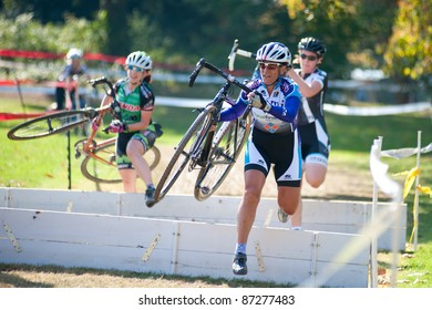 WASHINGTON, DC - OCTOBER 23: Unidentified cyclists compete in the DC Cyclocross competition on October 23, 2011 in Washington, D.C.