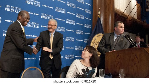 WASHINGTON, DC - OCTOBER 31: Republican Presidential contender Herman Cain is congratulated by campaign manager Mark Block after a speech at the National Press Club, October 31, 2011 in Washington, DC