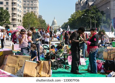 WASHINGTON D.C. - OCTOBER 8: Protesters march through the Nations capitol   during the 2011 Occupy movement on October 8, 2011 in Washington D.C.