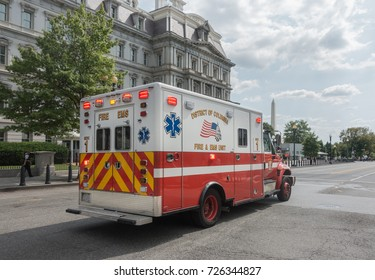 WASHINGTON, DC - SEPT. 21, 2017: EMS ambulance responding, Washington Monument and Executive Office Building background. EMS is part of fire department in Washington - DCFEMS.