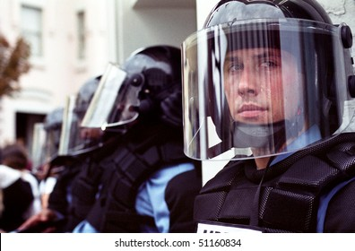 WASHINGTON, DC - SEPT 27: Police in full riot gear and batons guard Gap stores during anti-sweatshop protests on Sept. 27, 2002 in Washington, DC.