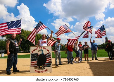 "Washington, DC - September 16, 2017: Protesters gather on the National Mall for a protest in support of President Donald Trump, deemed the ""Mother of all Rallies"" (MOAR)."
