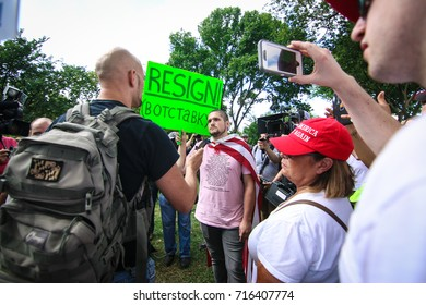 """Washington, DC - September 16, 2017: Trump supports surround an anti-Trump protester during a rally in support of President Donald Trump, deemed the """"Mother of all Rallies"""" (MOAR)."""