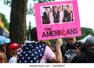 """Washington, DC - September 16, 2017: An anti-Trump protesters faces opposition during a rally in support of President Donald Trump, deemed the """"Mother of all Rallies"""" (MOAR)."""