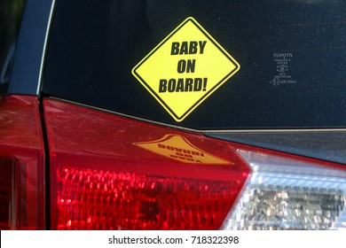 Washington, DC - September, 2017: A car's bumper sticker warns other drivers to drive slow because there is a baby on board.