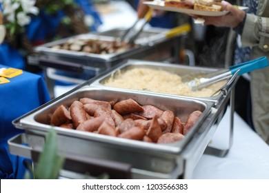 Washington, DC - September 27, 2018: Sausages and Sauerkraut are served at an German Oktoberfest themed networking event.
