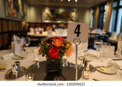 Washington, DC - September 30, 2018: A dining room table is elegantly decorated with flowers and expensive silverware for a fancy dinner.