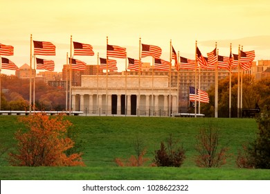 Washington DC skyline including Lincoln Memorial and American flags.