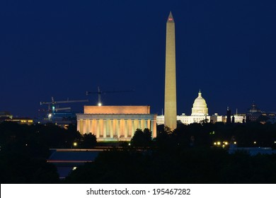 Washington DC skyline at night including Lincoln Memorial, Washington Monument and United States Capitol building